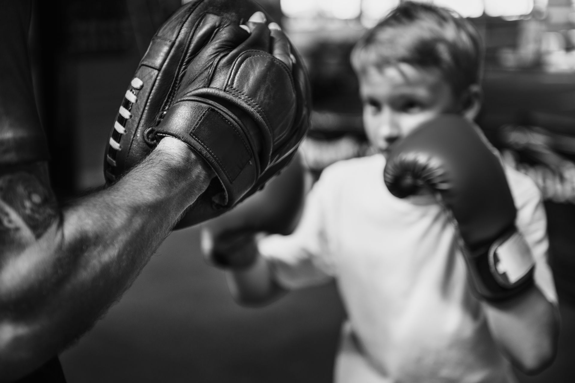 boy-boxing-training-punch-mitts-exercise-concept-PSYNPUU.jpg